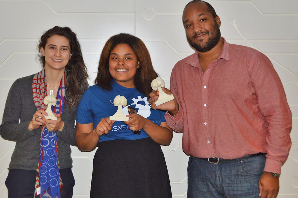 A photo of Rin Yunis, Jaycee Holmes, and me—we are each holding a 3D-printed trophy that is shaped like a brain.