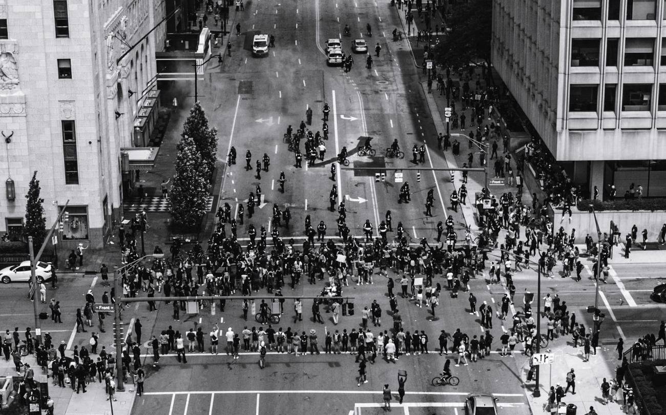 Black and white picture of people gathering for a protest.